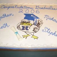 Graduation Cake For High School Graduation This was a 1/2 chocolate 1/2 white graduation cake for my son, two of his cousins and a neighbor who all graduated from the same school....