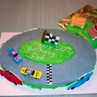 Nascar Birthday Cake I made this cake for my dad's 50th birthday. Cars on side of cake and Flag are made out of Rolled marshmello fondant and painted with...