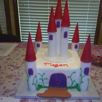 Princess Castle Cake Marble cake iced in buttercream with Styrafoam towers. fondant windows and path.