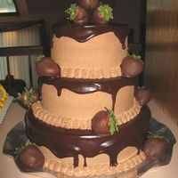 "Chocolate Wedding Cake I did this cake for my SIL's wedding reception. It's a 10"", 8"", 6"" chocolate fudge cake iced and filled with..."