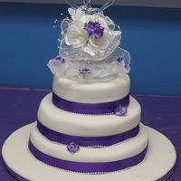 "080.jpg My sons wedding cake6"", 8"" and 10"" round, with purple ribbon around fondant"