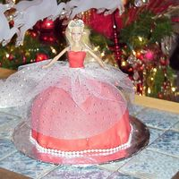 Holiday Birthday Cake Chocolate cake with vanilla filling covered in Satin Ice.