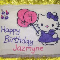 Hello Kitty 9x13 cake with Hello Kitty holding balloons