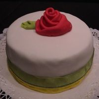 Red Rose   fruit cake converd in fondant and with a fondant ribbon rose