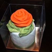 Orange Rose   mini cake with a orange ribbon rose in fondant