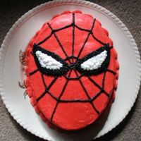 Spiderman  I had an extra layer of cake leftover so I made this up for my boyfriend in about 10 minutes. He took it to work the next day for a co-...