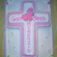1St Holy Communion   buttercream icing. 1/2 sheet cake with Wilton cross pan on top