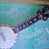 Banjo layered cakes buttercream and royal icing...jewelry making material for strings.