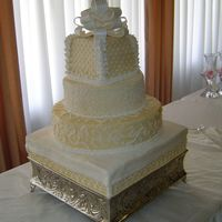 My First Wedding Cake   multiple two layer tiers each tier was a different flavor, all buttercream icing