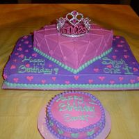 "1St Birthday For A Princess   1/2 sheet with 2 10"" layers, 6"" round smash cake buttercream and royal icing."