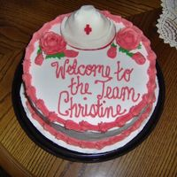 "Welcome To The Nursing Team Cake a french vanilla 8"" round with BC and MMF nurse's cap"