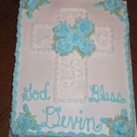 Baby Christening Cake 12 x 18 half chocolate half french vanilla cake with BC frosting. Roses and cross also in BC. HUGE HUGE HUGE cake!