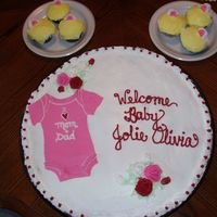 Baby Shower Cupcake Cake CCC made from about 40 cupcakes. Frosted in BC and onsie is MMF