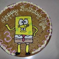 "Spongebob Cookie Cake  A giant 12"" chocolate chip cookie with a mmf spongebob. Made for my bf's little sister with help from my bf and his other sister..."