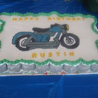 Motorcycle Cupcake Cake   I had a little trouble freehanding the motorcycle, but other than that I am pleased with my second attempt at a cupcake cake!