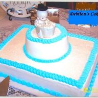Baby In Bathtub yellow sheet cake with round white cake on top with precious momentfigurine