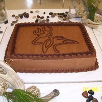 Ashtin Grooms Cake Chocolate two layer cake with chocolate icing as filling,,