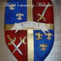 Medieval Shield I made this rolled fondant medieval shield for my 10 years old son. He raves about medieval stuff and since it was his birthday's...