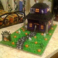 Haunted House   This cake was done for my girl's school. It won first place in the contest and was auctioned to the highest bidder.