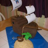 Pirate Ship For 2Nd Birthday The ship was made from a sheet cake that was cut in thirds, stacked and carved. It is covered with BC and fondant. Accents were done with...