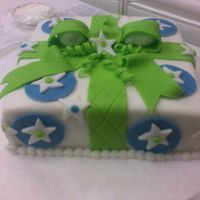 Wilton Class 3---Gift (Package) Cake  Fondant covered butter cake with fondant bow, circles, stars, and dots.I had a blast in this class! The instructor and the other students...