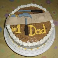 For My Dad   Fondant tools and belt over a German Chocolate cake.