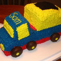 Dump Truck My son's first birthday cake. My husband made fun of the wheel placement...said he has never seen a dump truck like that before!! Oh...