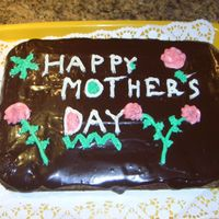 My Mothers Day Picture   Chocolate cake with chocolate glaze and white icing.