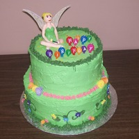 Tinkerbell Chocolate and vanilla layered cake, with vanilla buttercream frosting, Flowers are fondant. Tinkerbell is fondant with a little CMC. Tink&#...