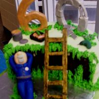 Dad's 60Th The cake is chocolate-raspberry with a ganache filling. Fondant icing and most figues. The 6, 0 and ladder are pastillage.