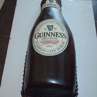 Guinness Bottle For a 21st birthday. Covered on chocolate fondant with edible images.