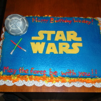 Star Wars 1/2 choc , 1/2 yellow cake with butter cream and fondant accents. For a friend's son's bday party