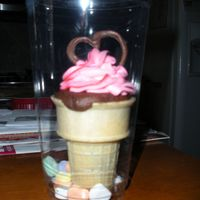 Valentines Cone Cupcakes choc cake baked in ice cream cones. White choc. raspberry cream cheese frosting and choc. hears for decorations. Placed in clear cups with...
