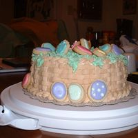 Easter Basket Cake  The cake is lemon cake with cheesecake filling. The eggs are NFSC with Royal Icing. My husband says it doesn't exactly look like an...