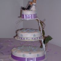 Purple Daisy Wedding  This is the wedding cake I did for my sister. I made purple gumpast daisies and dusted them with lustre dust. The cake topper was made by...