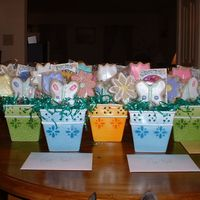"Easter Cookie Bouquets These are the cookie bouquets I did for Easter. NFSC and Royal Icing. I also put seed packets in there, so they can plant ""real""..."