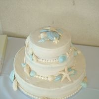 "Beach Wedding This is my first ""official"" wedding cake. The couple was married in Mexico on the beach, then came back to have a beach themed..."