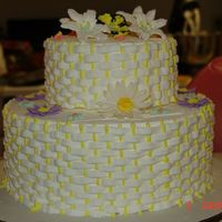 Diamond In The Ruff!! I done this, now completed though, to show my students how a basket weave can be beautiful for a tiered cake. I had brought some flowers to...