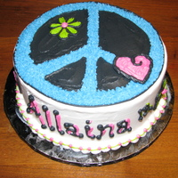 Allaina's Cake My niece's birthday cake. She loves peace signs, hearts and flowers...This is what I came up with...She loved it :)