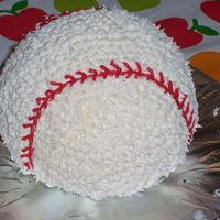 My First Baseball Cake Made this for my son's 7th Birthday!...First time using star tip!!!! Had a little getting used to!!!....but had fun doing it!...and of...