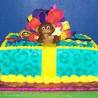Monkey!!! I made this for my daughter's 9th birthday. The cake is frosted with butter-cream w/a fondant monkey and bow. This was my first try...