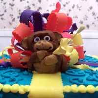 Monkey-Detail I made this for my daughter's 9th birthday. The cake is frosted with butter-cream w/a fondant monkey and bow. This was my first try...