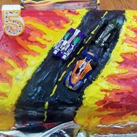 Hot Wheels Cake  This cake was made for my son's 5th birthday. I used the colors that were in the Hot Wheels plates and decorations. He thought it was...