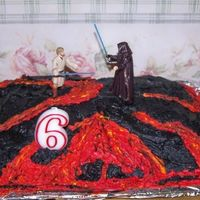 Star Wars Cake  I made this cake for my son's 6th birthday. It is supposed to resemble the final battle scene in the latest Star Wars movie that takes...