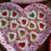 Valentine Sugar Cookies These are made of sugar cookies. I cut the center out and put a peice of different colored jolly ranchers in the middle before baking. Then...