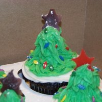 Christmas Tree Cupcakes I made these for the staff at my sons elementary school. They are chocolate fudge with creme de menthe filling and creme de menthe icing. I...