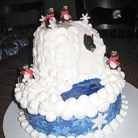 Penguin Birthday Cake  Hi! I made this cake for a girl's 11th birthday. It is a white cake with nutella buttercream filling. Buttercream icing, gel pond and...