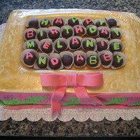 "Box Of Candy Birthday Cake Four layers of sheet cake were used with the top middle cut out to create a ""box"" of mimi chocolate covered oreos. Marbled pink..."