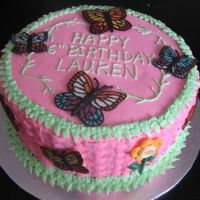 Butterfly Garden Party 12-inch round cake, with basketweave, and chocolate decorations. Used molds for the flowers and traced butterfly clip art with melted...