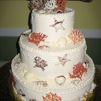 Sea Shell And Coral Wedding Cake This is my first wedding cake! Sea shells and coral are made from white chocolate marbled with other colors. Buttercream frosting. 14/10/6...